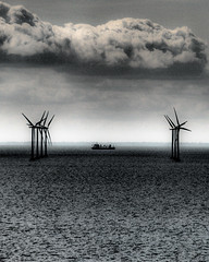 Dark Coast, Dark Ship (nosha) Tags: sea sky nature water windmill beautiful beauty clouds copenhagen denmark coast scary nikon ship power wind sweden apocalypse septe