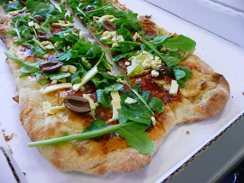 Rocket, feta and olive pizza