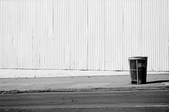 I Stand Alone (Brian Auer) Tags: california city urban blackandwhite bw sunlight film wall outside 50mm town blackwhite alone pattern unitedstates sandiego outdoor hill naturallight sidewalk single fujifilm neopan grayscale trashcan asa400 minoltasrtsuper 135format negativebwfilm