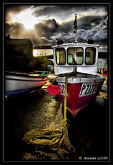 The clouds are gathering (JKmedia) Tags: uk sunset sea sky sunlight clouds canon boats eos coast fishing cornwall harbour dramatic rope explore cornish penzance pz mullion buoyant 40d platinumphoto colorphotoaward 15challengeswinner goldstaraward jkmedia pregamewinner