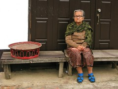 I was taking a photo of the red tray and she just sat down - Luang Prabang, Laos