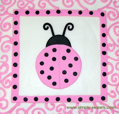 pink and black ladybug themed baby shower cake top view