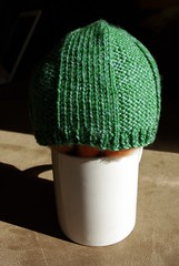 baby hat stuffed with fiber on a mug
