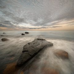 black rock sunset (H o g n e) Tags: ocean longexposure sea summer sky cloud seascape motion beach water norway rock stone clouds landscape evening coast landscapes carved solitude waves seascapes wind dusk horizon smooth shoreline wave glacier erosion explore pebble shore silence glaciers pebblebeach geology oslofjord archipelago vestfold breakingwaves carvedstone carvedrock smoothwater smoothsurface smoothstone slagentangen bildekritikk smoothrock vertorama silkwater