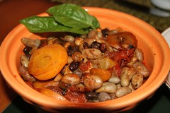 cooked beans in orange bowl