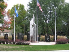 "Title: ""Northfield Area Veterans Memorial""Sculptor: Jeff Anderson, designerAccessible to Public: yes, outdoorsLocation: Riverside Lion's ParkOwnership: City of NorthfieldMedium: stainless steel, stone, and bronzeDimension: largeProvenance: American Legion Post 84, Post 4393 of the VFW, City of Northfield Year of Installation:2005Physical Condition: good"