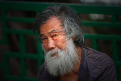 Suspicion (Michael Steverson) Tags: china park old fab man canon beard asian walk chinese games hong kong explore chinadigitaltimes meet allrightsreserved expatriate flcikr 40d smotd platinumheartaward expatriategames ctrippic
