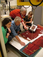 X-raying the tunic. From left: Elizabeth-Anne Haldane, Paul Robins (V&A), Dr. Sonia O'Conner (Bradford University) and Sara Gillies.