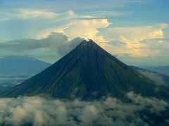 Moving Back a Bit over Legaspi (Storm Crypt) Tags: sea sky mountain clouds volcano lava flying earth smoke philippines aerial outline sulfur bicol sulfurdioxide magma pilipinas legaspi volcanology earthscience stratovolcano seismology albay pyroclastic wowphilippines legaspicity pacificringoffire