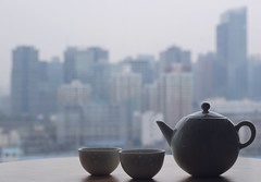 Urban teatime (NowJustNic) Tags: china home cup ceramic table 50mm nikon view apartment bokeh spin beijing teapot   teacup teatime towerblock apartmentblock starrynight chaoyang nff  d80 garywang pingguo ceramicsiown