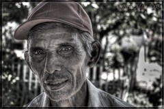 God Father (NeilsPhotography) Tags: portrait people indonesia sharp 2008 sulawesi godfather soe hdr mutedcolours rtwoverland