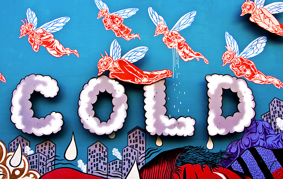 street art: the word COLD in puffy white lettering, with red bug-people flying over top