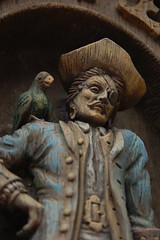 The Pirate and His Parrot (figmentfan84) Tags: world wood sculpture sign restaurant orlando nikon florida pirates magic tacos parrot kingdom disney carving relief pirate magickingdom pirata adventureland mexicanrestaurant perico d40 nikond40 disneyphotochallenge elpericoylapirata