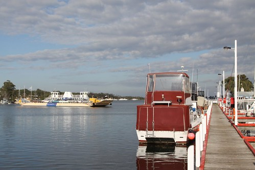 Raymond Island Ferry passing moored boats at Paynesville