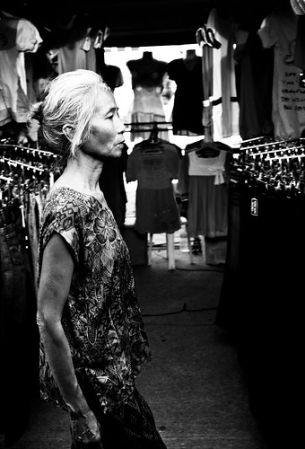 Elderly woman walking in market - Pimai Issan, Thailand