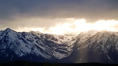 Breaking Sun Over the Mountains (IsthmusMediaGroup) Tags: travel sunset vacation sun snow nature water rockies hiking roadtrip beam backpacking valley fault rockymountains wyoming teton glacial mountainrange grandtetonnationalpark sigma1020 godray westernunitedstates crispair canonxsi