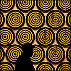 aim high (barbera*) Tags: toronto black silhouette yellow wall person circles numbers target 2008 darts concentric nuitblanche artinstallation 230am dartboards jacobdahlgrenfarsta 78271204
