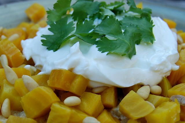 Hummous with caramelized onions and garlic topped with golden beets, pinenuts and greek yogurt