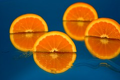 Oranges and reflection (Marite2007) Tags: blue food orange reflection closeup mirror still healthy natural reflected halves oranges concepts aliment citrusfruit ysplix