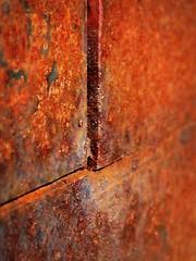 11.17.08 (sunshadows) Tags: macro wall austin rust steel diagonal oblique 2011 allrightsreserved copyrightreserved betweenthecracks rustlines mjba