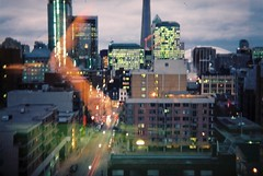 Downtown Window (margot.trudell) Tags: city urban toronto ontario canada film analog 35mm evening holga downtown cntower dusk ocad mccaul ontariocollegeofartanddesign