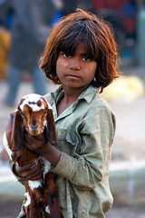 I Love My Baby Goat (Amir Mukhtar Mughal | www.amirmukhtar.com) Tags: pakistan people baby love girl canon children child innocent goat amir pakistani gipsy paki amirphotographyyahoocom