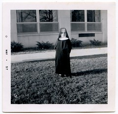 miniature nun (unexpectedtales) Tags: nun 1957 vernaculat old photo photograph halloween snap shot snapshot vintage antique surreal weird strange unusual black white vernacular found unexpectedtales peculiar wonderful enigmatic