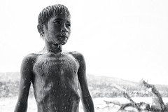 Steung Meanchey, Phnom Penh - Rain Rain come again little Sau Sau want to play! (Mio Cade) Tags: boy portrait wet monochrome rain shower bath cambodia khmer play sau tribute phnom penh soulfulness steung wernerbischof meanchey