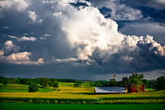 Rolling In (Loren Zemlicka) Tags: summer sky panorama storm rain wisconsin clouds rural landscape midwest shadows farm horizon country wide shed august hills fields crops agriculture 2008 wi thunder f4 rolling cultivation distant expanse cornrows 70mm paoli canoneos5d flickrexplore danecounty canonef70200mmf4lisusm