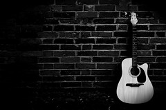 Guitar Wall (geeo123) Tags: music white black brick wall guitar sting golddragon aplusphoto payingmusic