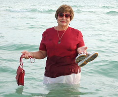 With the purse now getting wet, and clothes mostly soaked, it is time for a full drench and swim! Valerie didnt bother to shoreline her purse and shoes. They, along with all jewelry, went fully in, too!