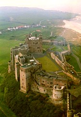 Bamburgh Castle (Peter Denton) Tags: uk england green castle film monument architecture 35mm movie coast eu aerialview northumberland scanned becket coastline analogue bamburgh fortress edifice richardburton filmlocation tynetees johngielgud lifeisart peterotoole lordarmstrong williamarmstrong peterdenton