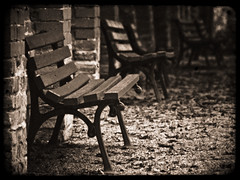 Benches (manganite) Tags: brick texture topf25 monochrome stone wall sepia digital germany dark bench point geotagged bayern bavaria nikon europe mood tl framed empty perspective atmosphere overlay monotone d200 nikkor dslr noise toned