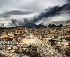 Pompeii and Mount Vesuvius (` Toshio ') Tags: street italy building history clouds walking volcano ancient alley rocks europe roman bricks perspective tourists walkway mountvesuvius pompeii vesuvius hdr europeanunion toshio highdynamicresolution aplusphoto