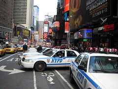 Yellow Cabs & NYPD - Time Square (Michael J Lynch) Tags: auto street city urban ny newyork cars yellow buildings photography photo downtown foto photographer photos cab taxi police nypd professional sidewalk transportation digitalcamera mikel officer eastcoast lsad nikond80 partol irishphotographer michaellynch limerickschoolofartanddesign wwwmichaellynchphotographycom michealoloinsigh artcollegegraduate fermoycocorkireland
