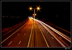 M6 Toll Road at Night (rjt208) Tags: road lighting uk greatbritain light england cars night canon flow effects eos evening long exposure traffic motorway britain trails toll passing m6 westmidlands 400d aplusphoto rjt rjt208 damniwishidtakenthat