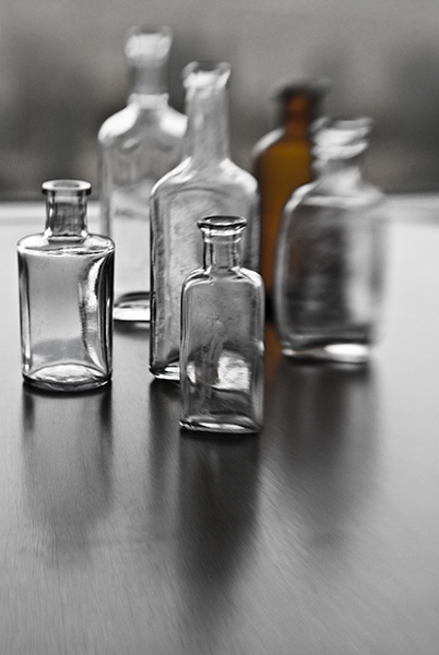 old bottles seen with a lensbaby