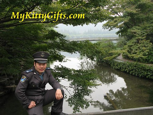 Hello Kitty taking Photograph of Security Guard in Peony Garden, HangZhou