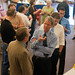 A faculty author reception was held in the campus center for faculty to display and discuss their books.