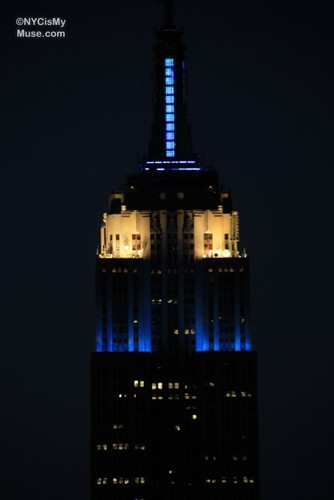 Close-up of Empire State Building in blue & white for Israel parade