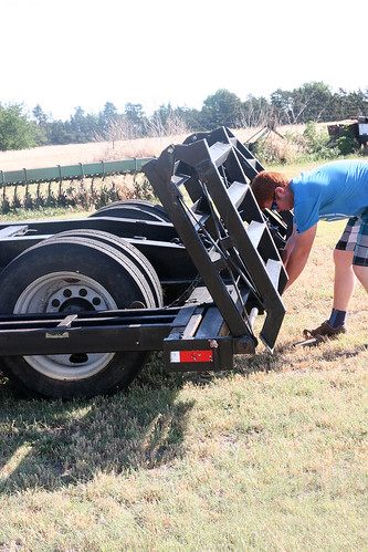 Callum get hitches switched around so he can start to load the clean machinery.