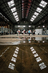 Rehearse (Lil [Kristen Elsby]) Tags: reflection architecture puddle dance industrial rehearsal interior wideangle symmetry flashphotography mardigras socialdocumentary rehearse reportage rainwater carriageworks sydneymardigras documentaryphotography eveleigh sydneygayandlesbianmardigras mardigras2008