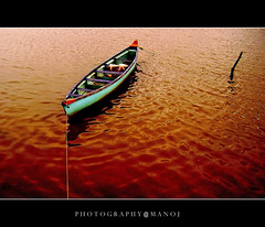 Captain--Out of range!! (Manoj Aswathi's Travel& Photography.) Tags: travel red tourism water rain river boat stream kerala monsoon ripples karnataka keralam mangalore rainyseason malabar godsowncountry ropped sultanbattery goldstaraward malayalikkoottam aswathi233 mtv233 photographymanoj manojphotography
