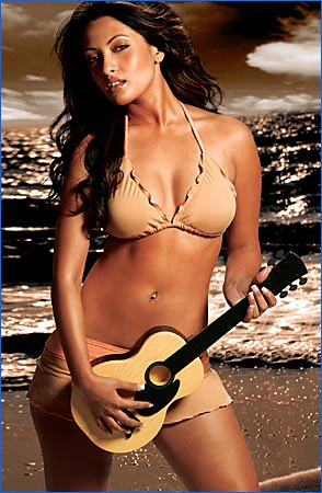 Sexy bikini woman India with ukulele