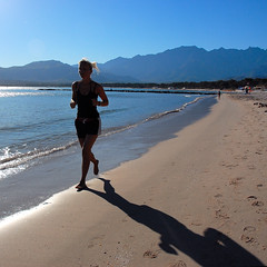 early morning exercise at the beach of Calvi, Corsica (Werner Schnell (1.stream)) Tags: morning shadow beach girl sport nikon corse calvi corsica jogging ws korsika mywinners abigfave wernerschnell