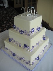 Purple Flowers Wedding Cake (pastrybitch) Tags: cake purple weddingcake buttercream fondantflowers