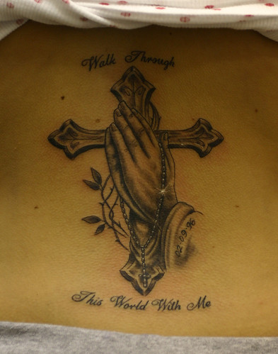 rosary beads tattoo on the hand.  Praying-hands-cross-and-rosary-beads-tattoo
