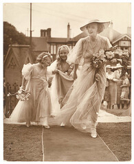 Bridesmaid and two flowergirls enter the church, St. Marks, Darling Point, c. 1930s by Sam Hood (State Library of New South Wales collection) Tags: flowers wedding hat vintage bride calla australia lilies bridesmaid hood flowergirls darlingpoint statelibraryofnewsouthwales ladiesfashion samhood hoodcollection