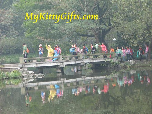 Hello Kitty taking Photograph of Lovely Children over Bridge in Peony Garden, HangZhou