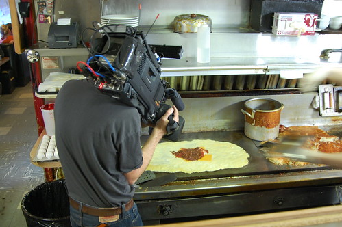 Camera man films stunt omelet